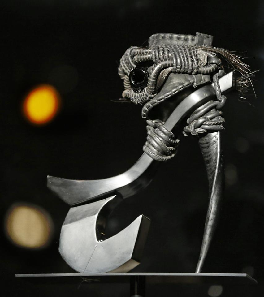 "This Feb. 11, 2013 photo shows Masaya Kushino's ""Storm Horse"" shoe, which features strands of a horse's mane, is displayed at the ""Shoe Obsession"" exhibit at The Museum at the Fashion Institute of Technology Museum in New York. The exhibition, showing off 153 specimens, runs through April 13. (AP Photo/Kathy Willens)"