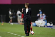 Japan's coach Asako Takakura watches her team against Canada during a women's soccer match at the 2020 Summer Olympics, Wednesday, July 21, 2021, in Sapporo, Japan. (AP Photo/Silvia Izquierdo)
