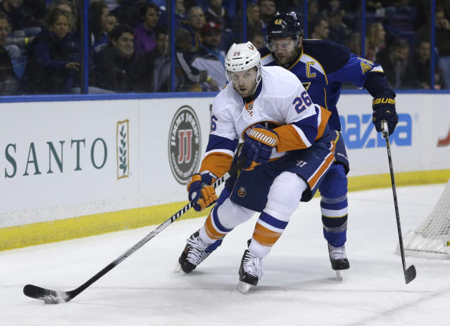 In this Dec. 5, 2013, photo, New York Islanders' Thomas Vanek, of Austria, looks to pass as St. Louis Blues' David Backes defends during an NHL hockey game in St. Louis. The Montreal Canadiens have acquired Vanek from the Islanders. Montreal sent forward prospect Sebastien Collberg, a 2014 second-round pick and a conditional fifth-rounder to the Islanders for Vanek on Wednesday, March 5, 2014. (AP Photo/Jeff Roberson)
