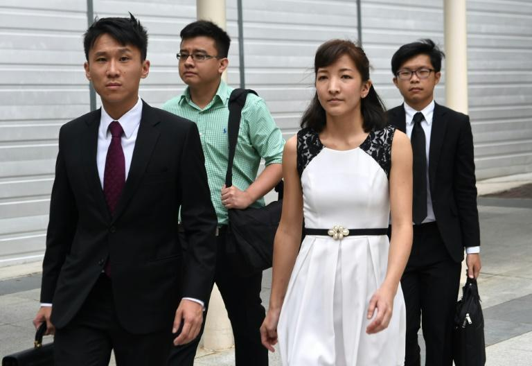 Australian Japanese Ai Takagi (front R), 23, and her Singaporean husband Yang Kaiheng (back L), 27, and their lawyer Choo Zheng Xi (front at L) leave the state court after a trial in Singapore on March 7, 2016