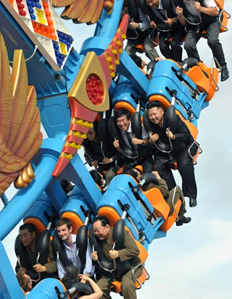 FILE - In this Wednesday, July 25, 2012 file photo released by the Korean Central News Agency and distributed in Tokyo by the Korea News Service Friday, July 27, 2012, North Korean leader Kim Jong Un, right in the middle, reacts as he takes a ride of an amusement attraction with Barnaby Jones, the first secretary and charges d'affaires at the British Embassy, second from left in bottom, during the completion ceremony of the Rungna People's Pleasure Ground in Pyongyang, North Korea. Foreign diplomats and officials were among those invited to attend the ceremony. (AP Photo/Korean Central News Agency via Korea News Service, File) JAPAN OUT UNTIL 14 DAYS AFTER THE DAY OF TRANSMISSION