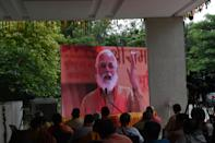 Members of the Bharatiya Janta Party (BJP) watch a live telecast on a screen of India's Prime Minister Narendra Modi (C) participating in the groundbreaking ceremony of the Ram Temple in Ayodhaya, at the Gujarat BJP headquarters in Gandhinagar on August 5, 2020. - India's Prime Minister Narendra Modi will lay the foundation stone for a grand Hindu temple in a highly anticipated ceremony on August 5 at a holy site that was bitterly contested by Muslims, officials said. The Supreme Court ruled in November 2019 that a temple could be built in Ayodhya, where Hindu zealots demolished a 460-year-old mosque in 1992. (Photo by SAM PANTHAKY / AFP) (Photo by SAM PANTHAKY/AFP via Getty Images)