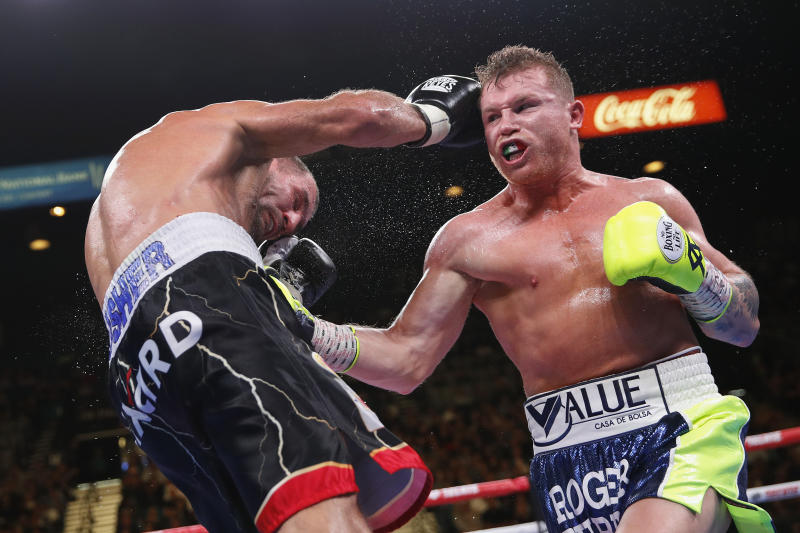 Canelo Alvarez, left, lands a punch against Sergey Kovalev during a light heavyweight WBO title bout, Saturday, Nov. 2, 2019, in Las Vegas (AP Photo/John Locher)
