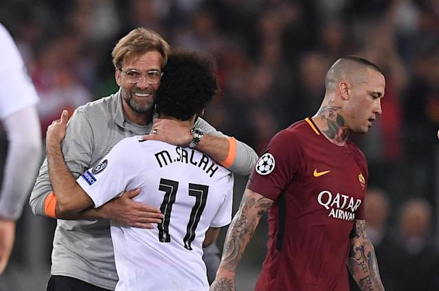<p>Soccer Football – Champions League Semi Final Second Leg – AS Roma v Liverpool – Stadio Olimpico, Rome, Italy – May 2, 2018 Liverpool manager Juergen Klopp celebrates after the match with Mohamed Salah as Roma's Radja Nainggolan looks dejected REUTERS/Alberto Lingria </p>