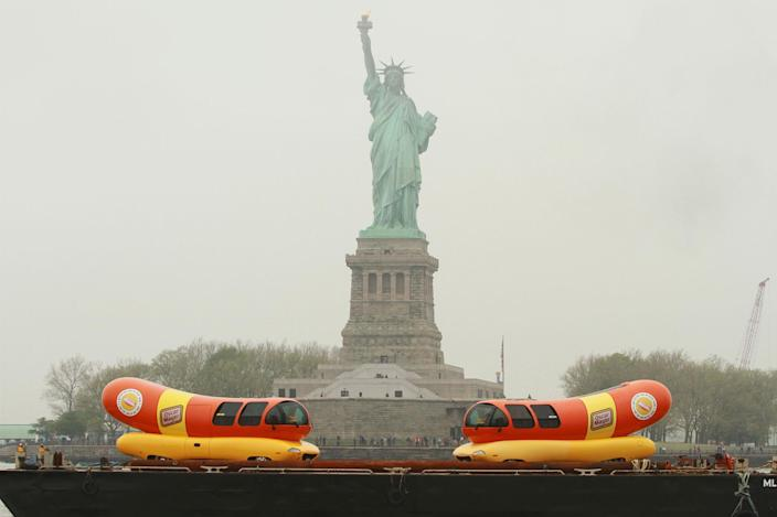 <p>On Monday, May 1, 2017, the Oscar Mayer brand announced major quality improvements being made to their total hot dog portfolio. Now, every single Oscar Mayer Hot Dog has no by-products, no added nitrates or nitrites (except those naturally occurring in celery juice), and no artificial preservatives in their meats; a first for a national manufacturer. To announce this bold move, the iconic Wienermobile traveled across New York Harbor on a barge, giving away free hot dogs. This move kicks off their summer-long mission of getting a better hot dog in people's hands across America, and how Oscar Mayer will go to great lengths #ForTheLoveOfHotDogs. This on-water journey is just the first stop of many on a tour that will take the Wienermobile vehicles to every corner of the country delivering a better dog. (Oscar Mayer via AP Images) </p>
