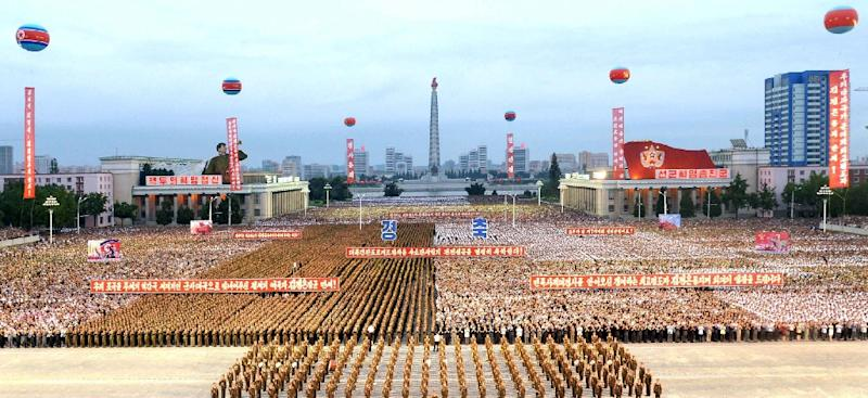 Tens of thousands of people gathered in Kim Il-Sung Square in a mass celebration for scientists involved in North Korea's nuclear test (AFP Photo/STR)