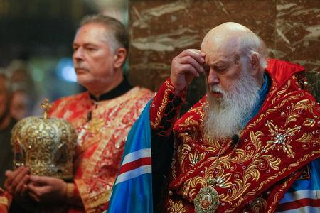 Patriarch Filaret, head of the Ukrainian Orthodox Church of the Kiev Patriarchate, prays as he conducts a service at the Volodymysky Cathedral in Kiev, Ukraine October 11, 2018. REUTERS/Valentyn Ogirenko