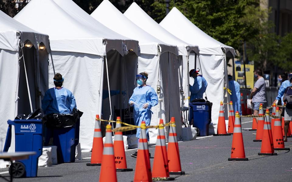 Medical Reserve Corps volunteers, nurses and District of Columbia Department of Health officials operate a walk-up COVID-19 testing site in Washington, DC - MICHAEL REYNOLDS/EPA-EFE/Shutterstock/Shutterstock