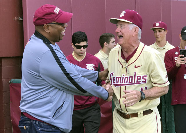 FILE - In this Feb. 19, 2017, file photo, Florida State athletic director Stan Wilcox, left, congratulates coach Mike Martin after Martin got his 1,900th win, defeating VCU 11-2, in Tallahassee, Fla. Florida State University has won national championships in three sports since Stan Wilcox took over as athletic director in August of 2013. Wilcoxs biggest moves though are expected to take place over the next 12 months. (AP Photo/Joseph Reedy, File)