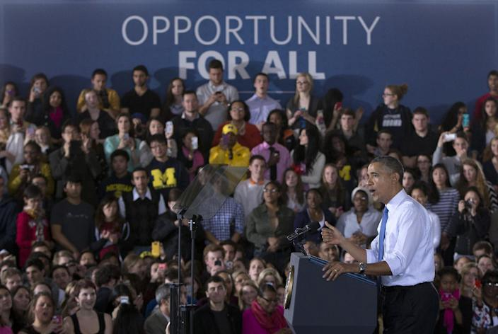 President Barack Obama speaks at the University of Michigan, Wednesday, April 2, 2014, in Ann Arbor, Mich., about his proposal to raise the national minimum wage. (AP Photo/Carolyn Kaster)