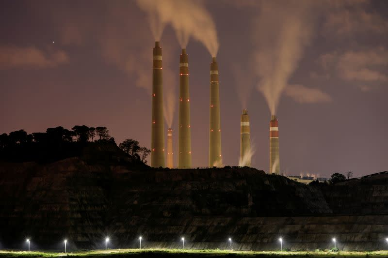FILE PHOTO: Smoke and steam billows from the coal-fired power plant owned by Indonesia Power, next to an area for Java 9 and 10 Coal-Fired Steam Power Plant Project in Suralaya