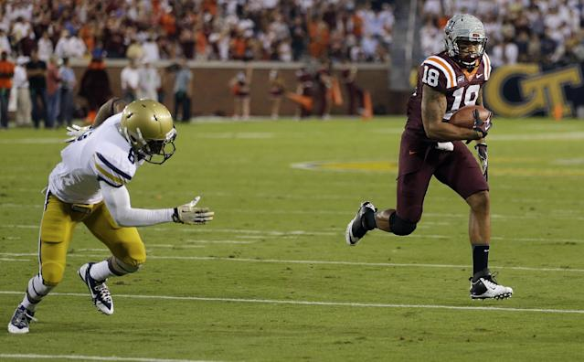Virginia Tech wide receiver D.J. Coles (18) outruns Georgia Tech cornerback Louis Young (8) to the end zone for a touchdown in the first half of an NCAA college football game on Thursday, Sept. 26, 2013, in Atlanta. (AP Photo/John Bazemore)