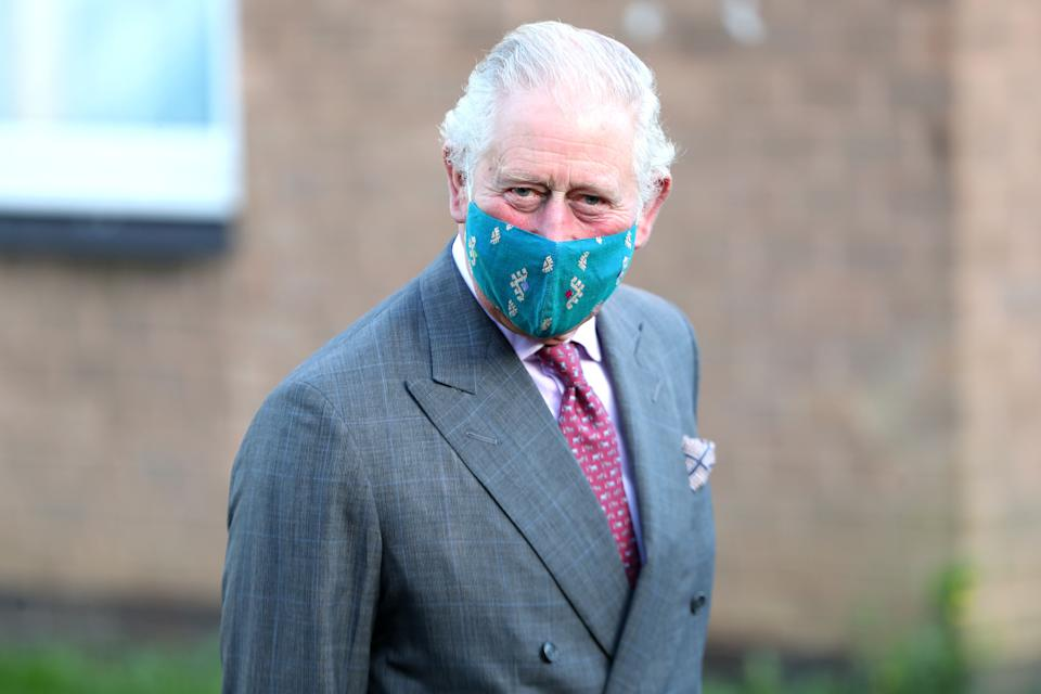 Britain's Prince Charles, Prince of Wales wearing a protective face covering to combat the spread of the coronavirus, visits the Gloucestershire Vaccination Centre at Gloucestershire Royal Hospital on December 17, 2020 in Gloucester, central England, to meet with front line health and care workers administering and receiving the Covid-19 vaccine. (Photo by Chris Jackson / POOL / AFP) (Photo by CHRIS JACKSON/POOL/AFP via Getty Images)