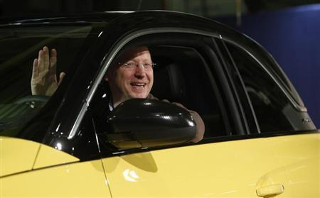 General Motors Vice Chairman, interim President of GM Europe and Chairman of the Opel Supervisory Board Girsky waves as he sits inside an Opel Adam car during the start of the car production in Eisenach