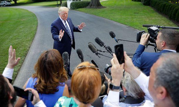 PHOTO: President Donald Trump speaks to members of the media before boarding Marine One helicopter on the South Lawn of the White House in Washington, for the short flight to nearby Andrews Air Force Base, Md., July 19, 2019. (Pablo Martinez Monsivais/AP)