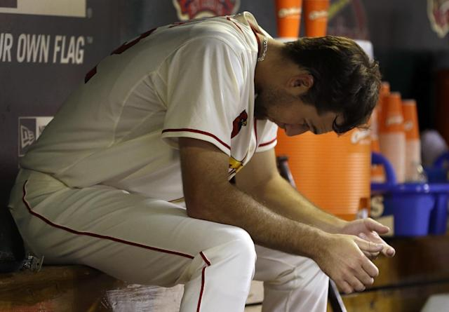 St. Louis Cardinals starting pitcher Michael Wacha sits in the dugout after being removed from a baseball game against the Seattle Mariners during the fifth inning, Saturday, Sept. 14, 2013, in St. Louis. (AP Photo/Jeff Roberson)