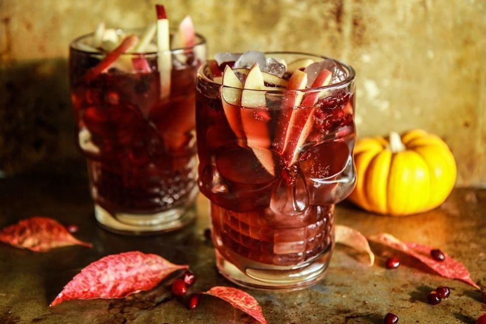 """<p>Turn a classic ginger cocktail into a Halloween drink by adding autumnal flavors like apple cider and pomegranate. To make it even scarier, serve it in a spooky skull glass!</p><p><a href=""""https://www.thepioneerwoman.com/food-cooking/recipes/a90060/spiced-apple-cider-pomegranate-moscow-mules/"""" rel=""""nofollow noopener"""" target=""""_blank"""" data-ylk=""""slk:Get the recipe."""" class=""""link rapid-noclick-resp""""><strong>Get the recipe. </strong></a></p><p><a class=""""link rapid-noclick-resp"""" href=""""https://go.redirectingat.com?id=74968X1596630&url=https%3A%2F%2Fwww.walmart.com%2Fsearch%2F%3Fquery%3Dskull%2Bglasses&sref=https%3A%2F%2Fwww.thepioneerwoman.com%2Fholidays-celebrations%2Fg36982659%2Fhalloween-drink-recipes%2F"""" rel=""""nofollow noopener"""" target=""""_blank"""" data-ylk=""""slk:SHOP SKULL GLASSES"""">SHOP SKULL GLASSES</a></p>"""