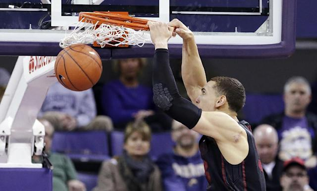 Stanford's Dwight Powell dunks against Washington in the first half of an NCAA college basketball game Wednesday, Feb. 12, 2014, in Seattle. (AP Photo/Elaine Thompson)