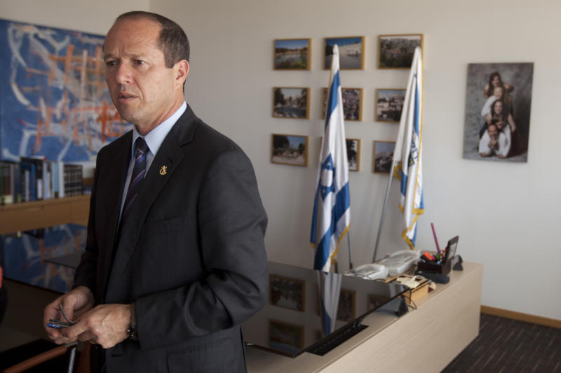 Jerusalem Mayor Nir Barkat stands during an interview with The Associated Press at his office in Jerusalem, Tuesday, Sept. 3, 2013. Barkat said any partition of the city as part of a future peace agreement will not work, insisting only a united city could function and thrive. (AP Photo/Sebastian Scheiner)