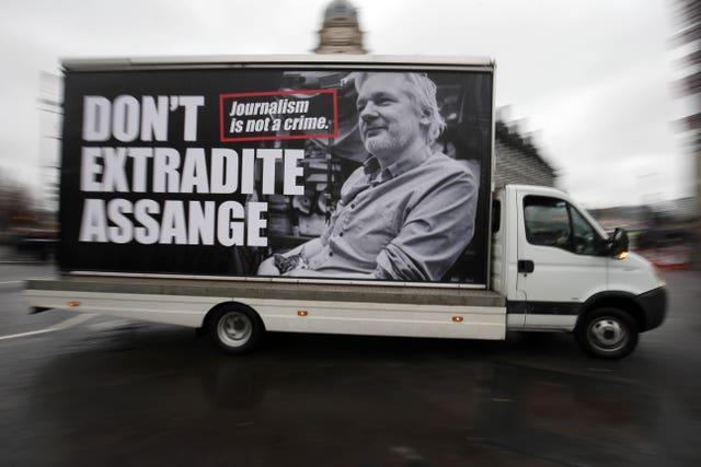 A van with an advert supporting Julian Assange circles Parliament Square in Westminster, London  (Jonathan Brady/PA)