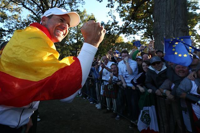 MEDINAH, IL - SEPTEMBER 30: Sergio Garcia celebrates with fans after Europe defeated the USA 14.5 to 13.5 to retain the Ryder Cup during the Singles Matches for The 39th Ryder Cup at Medinah Country Club on September 30, 2012 in Medinah, Illinois. (Photo by Andy Lyons/Getty Images)