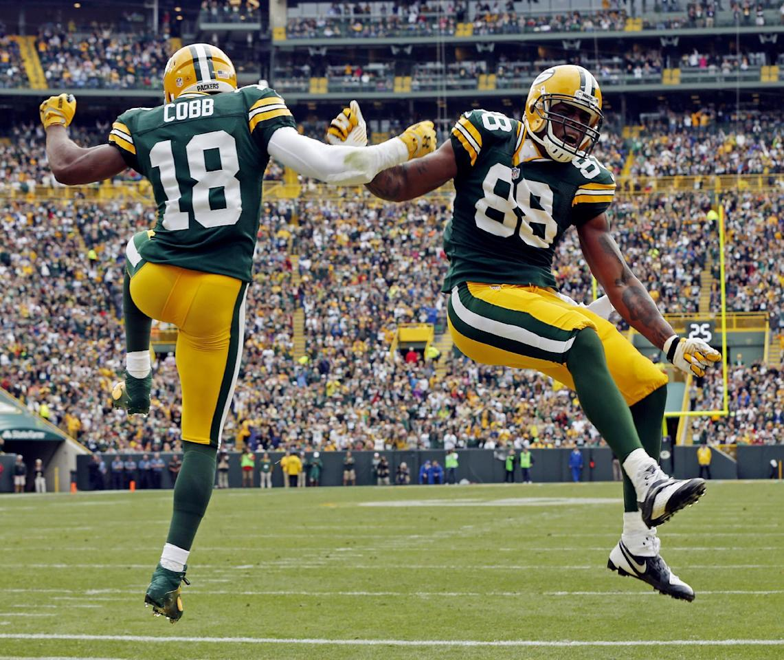 Green Bay Packers' Jermichael Finley (88) is congratulated by teammate Randall Cobb (18) after Finley's touchdown catch during the first half of an NFL football game against the Washington Redskins Sunday, Sept. 15, 2013, in Green Bay, Wis. (AP Photo/Mike Roemer)