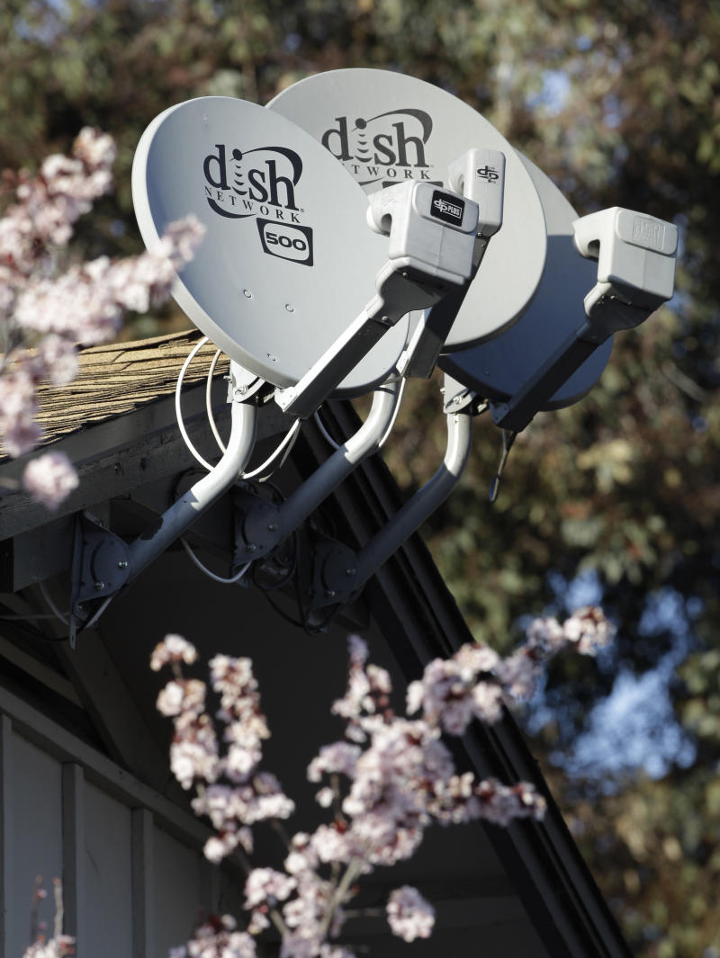 Three Dish Network satellite dishes are shown at an apartment complex in Palo Alto, Calif., Wednesday, Feb. 23, 2011. Dish Network, the nation's third-largest provider of pay-TV service, is reporting that its fourth-quarter net income rose 41 percent to beat Wall Street analysts' expectations, even as it lost subscribers.(AP Photo/Paul Sakuma)