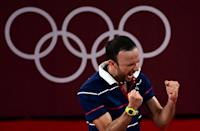 <p>Guatemala's Kevin Cordon (R) celebrates his win over Netherlands' Mark Caljouw in their men's singles badminton round of 16 match during the Tokyo 2020 Olympic Games at the Musashino Forest Sports Plaza in Tokyo on July 29, 2021. (Photo by Pedro PARDO / AFP) (Photo by PEDRO PARDO/AFP via Getty Images)</p>