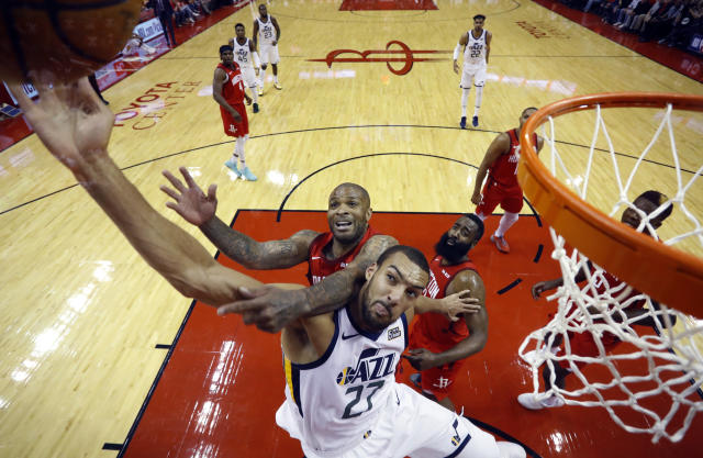 Utah Jazz center Rudy Gobert (27) is fouled by Houston Rockets forward PJ Tucker (17) as he tries to score during the first half in Game 5 of an NBA basketball playoff series, in Houston, Wednesday, April 24, 2019. (AP Photo/David J. Phillip)