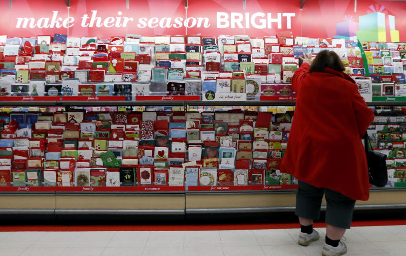 FILE - In this Dec. 19, 2012, file photo, a customer shops for greeting cards at a Target store in Chicago. It's that holiday-card time of year again. But before you open up the address book or spreadsheet, read up on some modern etiquette for how to address your recipients. (AP Photo/Nam Y. Huh, File)