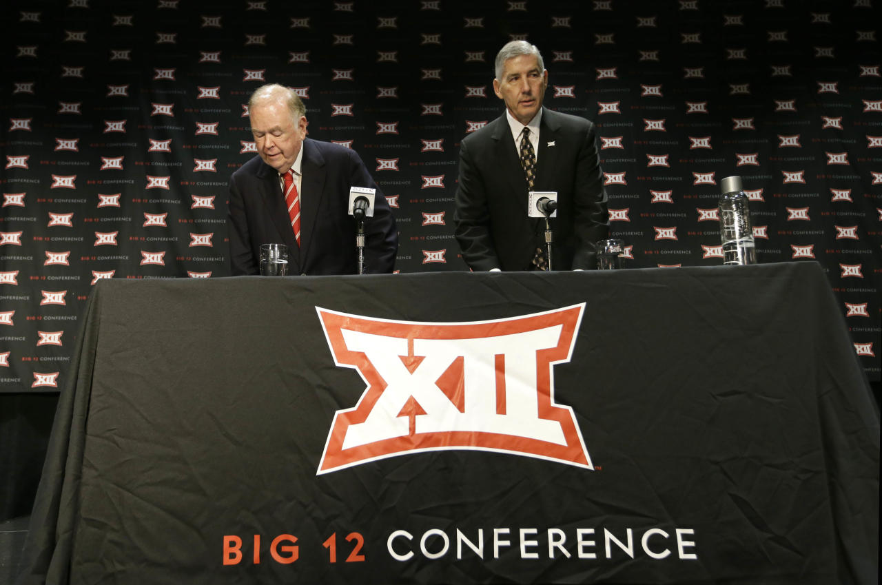 Big 12 Commissioner Bob Bowlsby, right, and Oklahoma President David Boren take their seat to speak to reporter after The Big 12 Conference meeting in Grapevine, Texas, Monday, Oct. 17, 2016. The Big 12 Conference has decided against expansion from its current 10 schools after three months of analyzing, vetting and interviewing possible new members. (AP Photo/LM Otero)