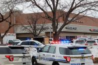 Police vehicles are seen at the scene where an active shooter was reported at a grocery store in Boulder