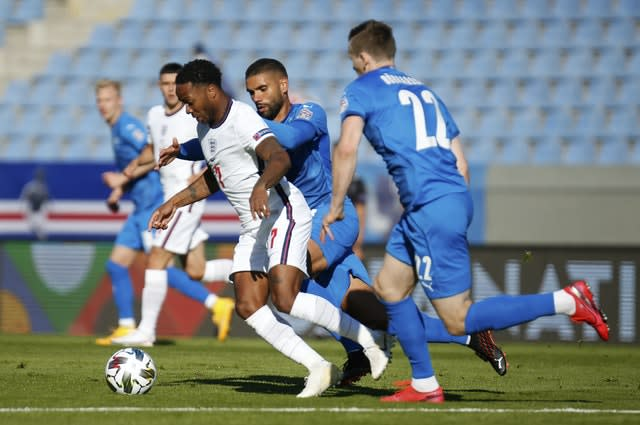 Raheem Sterling, left, is challenged by Iceland's Victor Palsson and Jon Dadi Bodvarsson