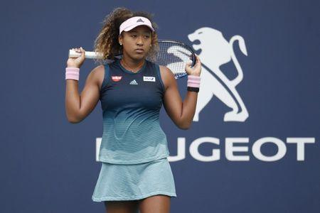 Mar 23, 2019; Miami Gardens, FL, USA; Naomi Osaka of Japan reacts after losing a point against Su-Wei Hshieh of Chinese Taipei (not pictured) in the second round of the Miami Open at Miami Open Tennis Complex. Mandatory Credit: Geoff Burke-USA TODAY Sports
