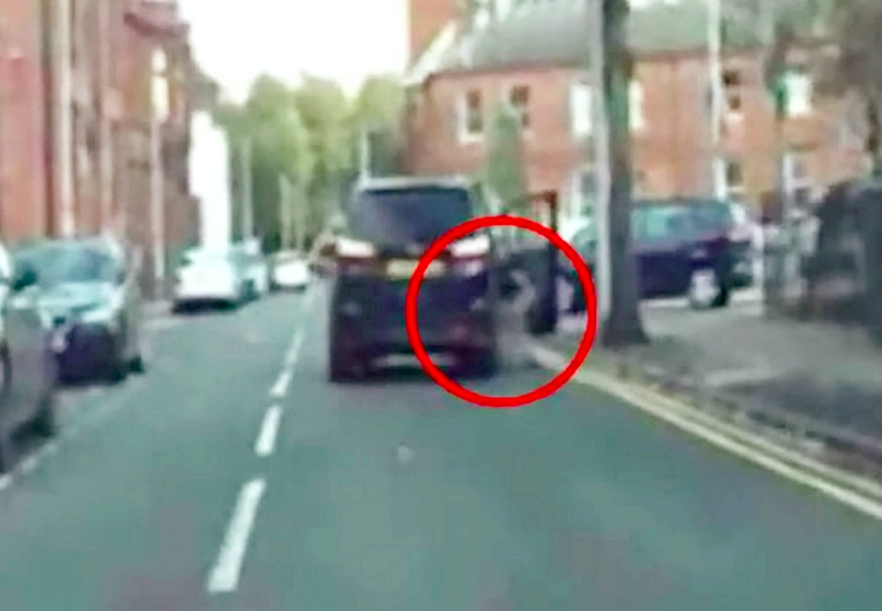 Dashcam footage shows the woman being dragged 65ft along Lodge Road in West Bromwich, West Mids. (SWNS)