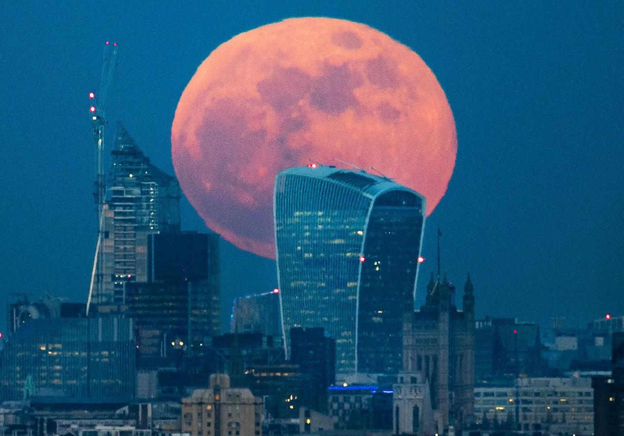 <p>A full blue supermoon rises behind 20 Fenchurch Street, known as the Walkie-Talkie building, as it rises over central London. Two full moons in the same calendar month is also know as a blue moon. (Rex)<br /> Blue moon over London, UK – 31 Jan 2018 </p>