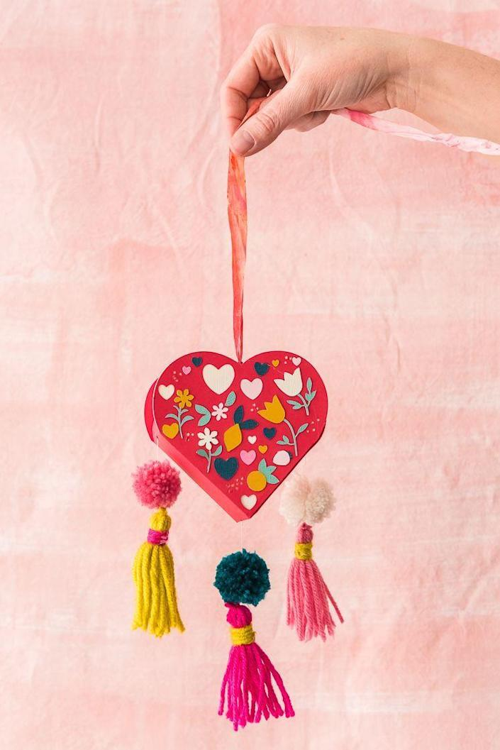 """<p>Tassels, florals, and an adorable heart shape add major charm to this gift box, which you can fill with just about anything you please.</p><p><strong>Get the tutorial at <a href=""""https://thehousethatlarsbuilt.com/2019/01/valentine-tassel-heart-favor-box.html/#more-36283"""" rel=""""nofollow noopener"""" target=""""_blank"""" data-ylk=""""slk:The House That Lars Built"""" class=""""link rapid-noclick-resp"""">The House That Lars Built</a>.</strong></p><p><strong><a class=""""link rapid-noclick-resp"""" href=""""https://go.redirectingat.com?id=74968X1596630&url=https%3A%2F%2Fwww.walmart.com%2Fip%2FU-S-Art-Supply-Professional-36-Color-Set-of-Acrylic-Paint-in-Large-18ml-Tubes-Rich-Vivid-Colors-for-Artists-Students%2F877776236&sref=https%3A%2F%2Fwww.thepioneerwoman.com%2Fholidays-celebrations%2Fgifts%2Fg32307619%2Fdiy-gifts-for-mom%2F"""" rel=""""nofollow noopener"""" target=""""_blank"""" data-ylk=""""slk:SHOP ACRYLIC PAINT"""">SHOP ACRYLIC PAINT</a><br></strong></p>"""