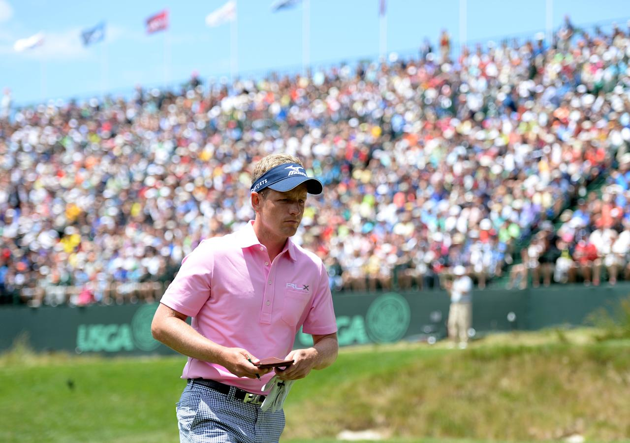 ARDMORE, PA - JUNE 14:  Luke Donald of England walks off the 17th hole during Round Two of the 113th U.S. Open at Merion Golf Club on June 14, 2013 in Ardmore, Pennsylvania.  (Photo by Ross Kinnaird/Getty Images)