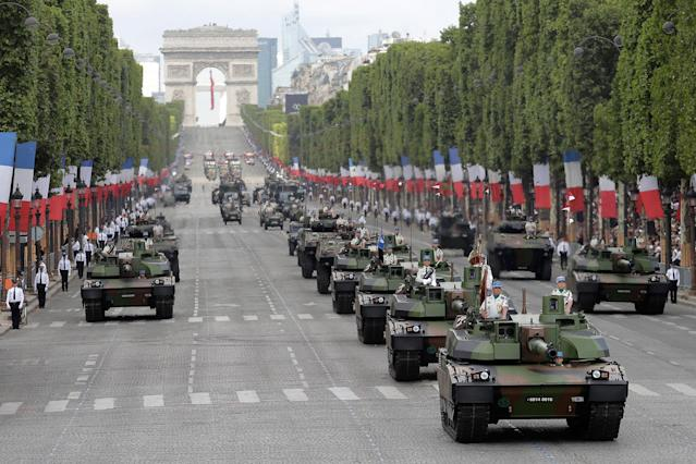 <p>Tanks drive down the Champs Elysees avenue during the Bastille Day parade in Paris, Friday, July 14, 2017. (Photo: Markus Schreiber/AP) </p>
