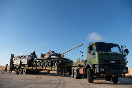 Libyan National Army (LNA) members, commanded by Khalifa Haftar, equip the military vehicles to get out of Benghazi to reinforce the troops advancing to Tripoli, in Benghazi, Libya April 13, 2019. REUTERS/Esam Omran Al-Fetori - RC1D53312530
