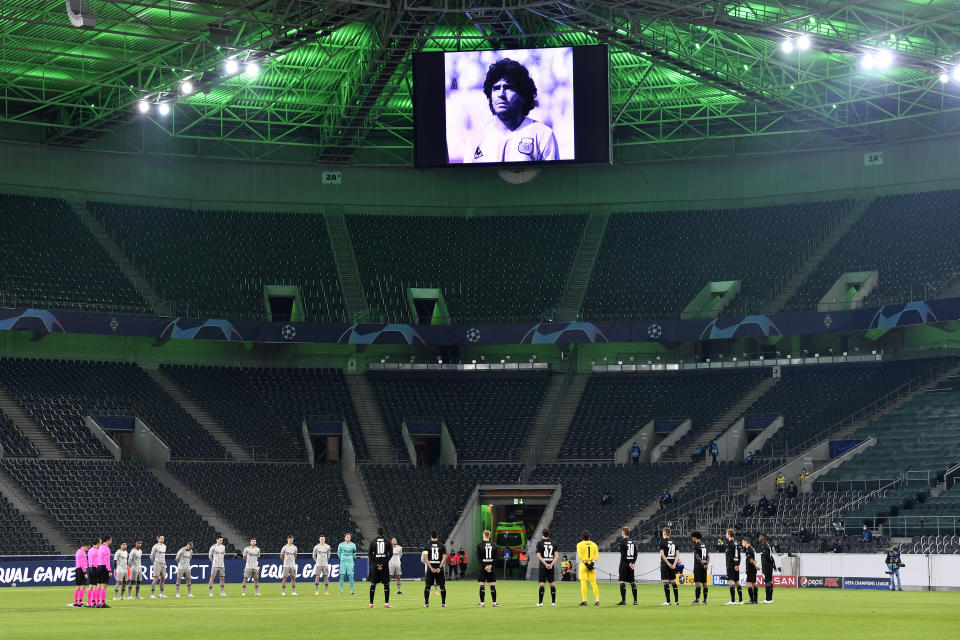 Players observe a minute of silence for former Argentina soccer great Diego Armando Maradona before the Champions League, Group B, soccer match between Borussia Moenchengladbach and Shakhtar Donetsk at the Borussia Park in Moenchengladbach, Germany, Wednesday, Nov. 25, 2020. (AP Photo/Martin Meissner)