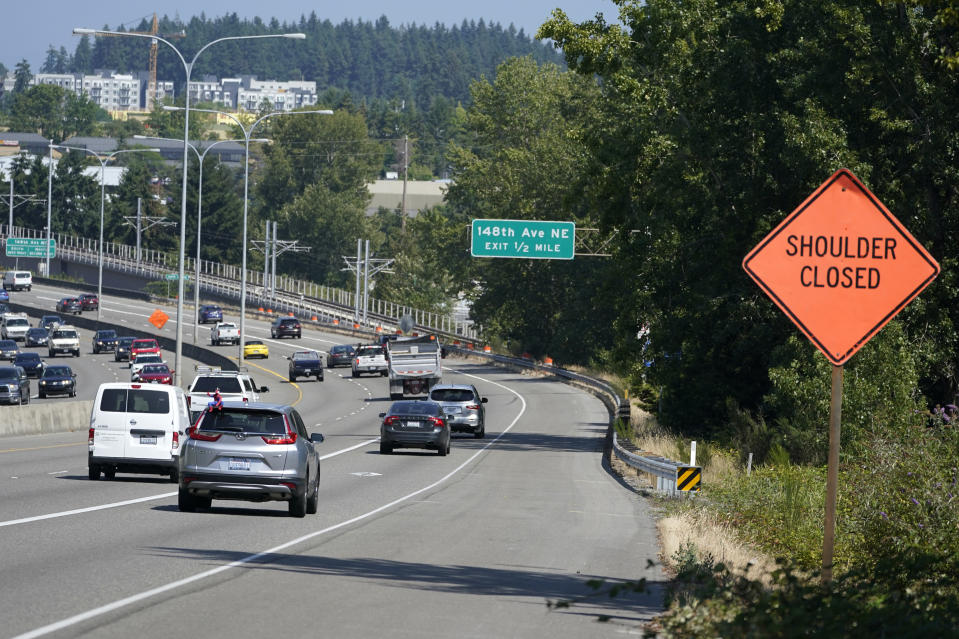 The eastbound lanes of Highway 520 are shown near the exit for 148th Ave. NE, Wednesday, July 14, 2021, in Redmond, Wash. Police said Wednesday that they were investigating a hit-and-run crash in the same area of the highway that could be tied to former Seattle Seahawks and San Francisco 49ers NFL football star Richard Sherman. Sherman is suspected of leaving his damaged car after the crash in the early morning hours and trying to force his way into a family member's home before he was arrested and booked into jail. (AP Photo/Ted S. Warren)