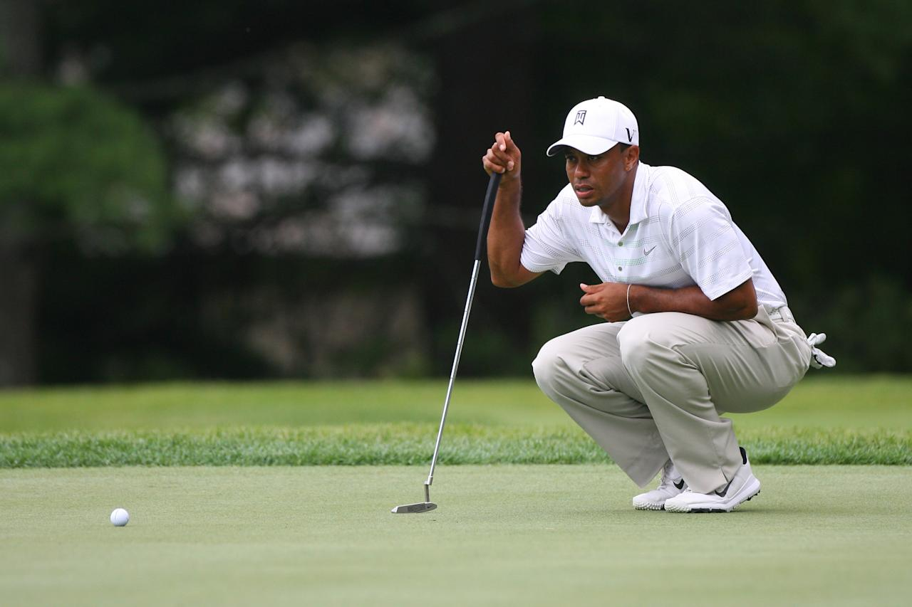 WHITE SULPHUR SPRINGS, WV - JULY 5: Tiger Woods lines up his birdie putt on the sixth hole during the first round of the Greenbrier Classic at the Old White TPC on July 5, 2012 in White Sulphur Springs, West Virginia. (Photo by Hunter Martin/Getty Images)
