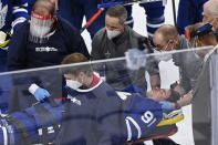 Toronto Maple Leafs forward John Tavares (91) is helped onto a stretcher after being injured during the first period against the Montreal Canadiens in Game 1 of an NHL hockey Stanley Cup first-round playoff series Thursday, May 20, 2021, in Toronto. (Frank Gunn/The Canadian Press via AP)
