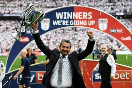 Soccer Football - Championship Play-Off Final - Fulham vs Aston Villa - Wembley Stadium, London, Britain - May 26, 2018 Fulham manager Slavisa Jokanovic celebrates promotion to the Premier League with the trophy Action Images via Reuters/Tony O'Brien