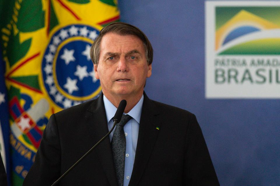 BRASILIA, BRAZIL - MARCH 22: President of Brazil Jair Bolsonaro speaks during the launch of Programa Aguas Brasileiras amidst the coronavirus (COVID-19) pandemic at the Planalto Palace on March 22, 2021 in Brasilia. Brazil has over 12.047,000 confirmed positive cases of Coronavirus and has over 295,425 deaths. (Photo by Andressa Anholete/Getty Images)