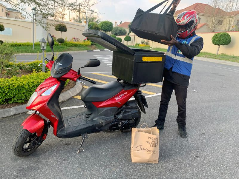 A Mr D Food delivery worker delivers grocery items