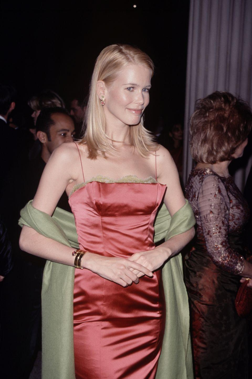 <p>In a Bulgari watch and elegant column gown...</p>