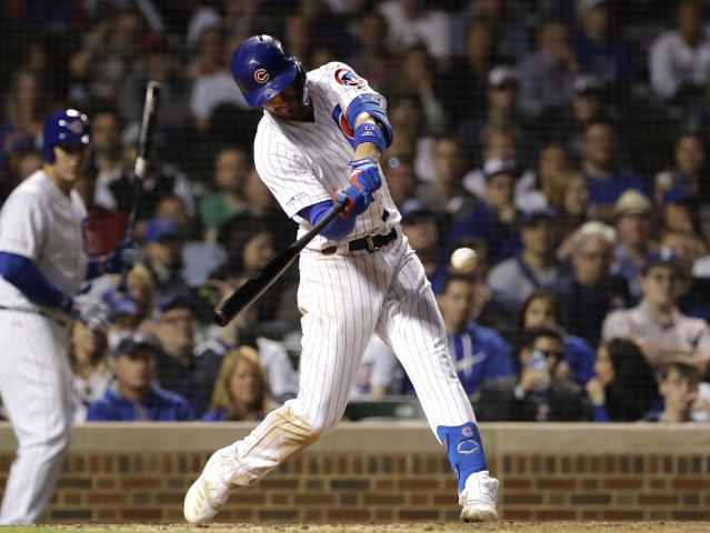 Chicago Cubs' Kris Bryant hits a grand slam during the eighth inning of a baseball game against the St. Louis Cardinals, Sunday, May 5, 2019, in Chicago. (AP Photo/Nam Y. Huh)