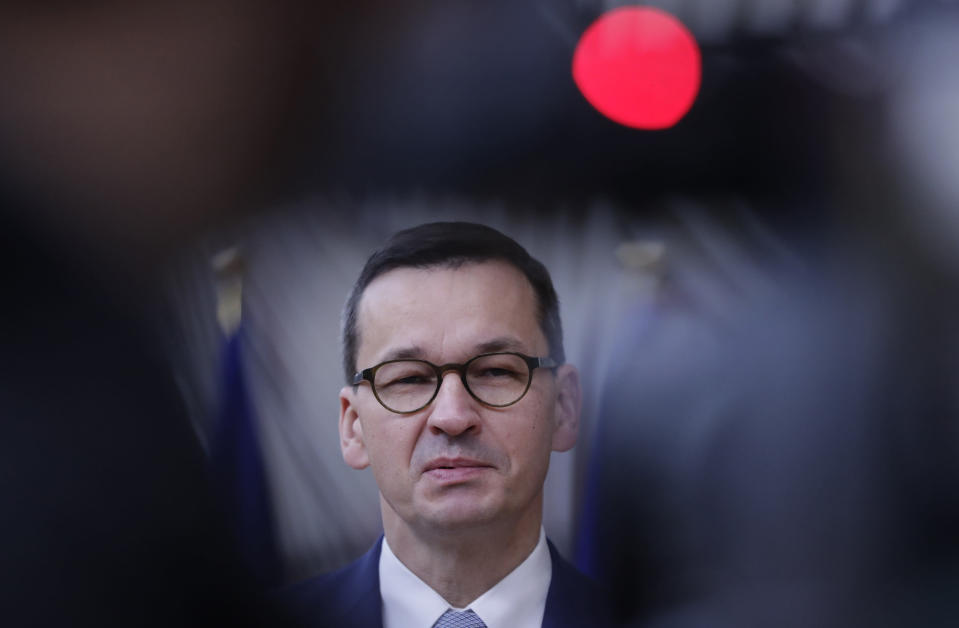 FILE - In this Oct. 2, 2020, file photo, Poland's Prime Minister Mateusz Morawiecki speaks on camera as he arrives for an EU summit at the European Council building in Brussels. The European Union still hasn't completely sorted out its messy post-divorce relationship with Britain — but it has already been plunged into another major crisis. This time the 27-member union is being tested as Poland and Hungary block passage of its budget for the next seven years and an ambitious package aimed at rescuing economies ravaged by the coronavirus pandemic. (Olivier Hoslet/Pool Photo via AP, File)